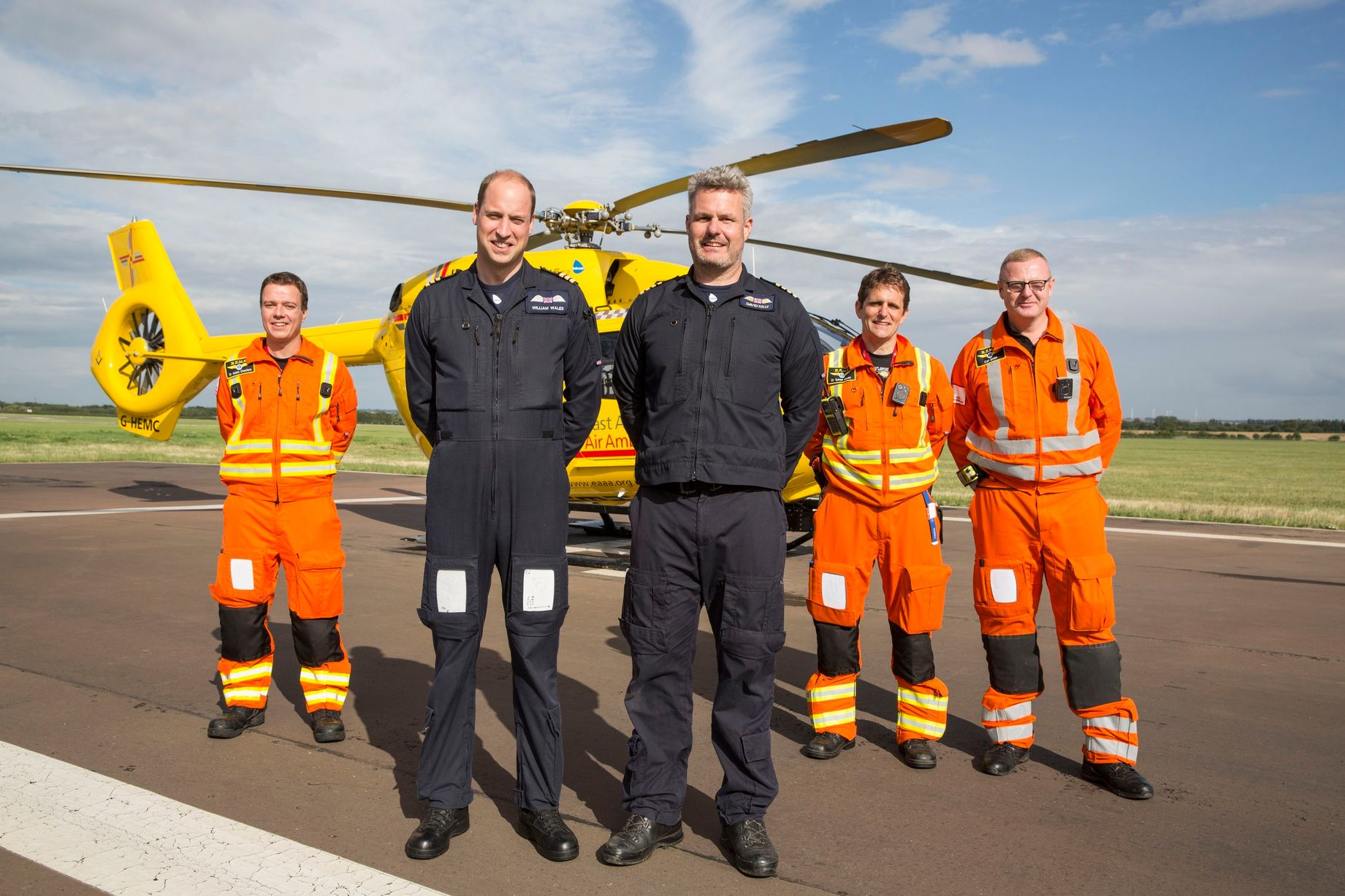 The Duke of Cambridge Poses for a final photo with the night shift crew as he starts his final shift with the East Anglian Air Ambulance based at Marshall Airport near Cambridge on July 27 Photo