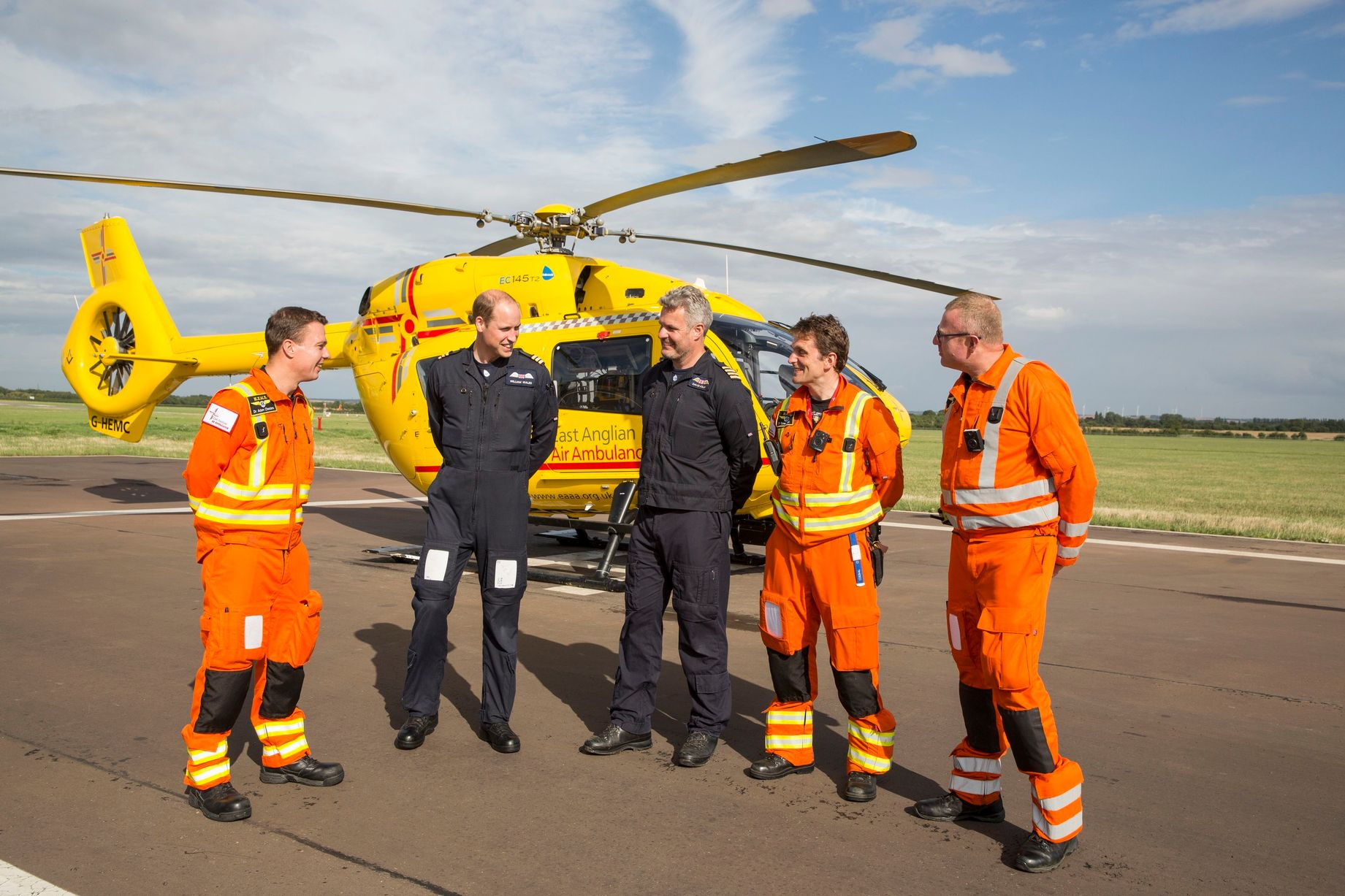 The Duke of Cambridge Poses for a final photo with the night shift crew as he starts his final shift with the East Anglian Air Ambulance based at Marshall Airport near Cambridge on July 27. (Left to right) Dr Adam Chesters, Prince William, Cpt Dave Kelly, Dr Tobias Gouse and CCP Carl Smith. Picture: Heathcliff O'Malley/The Daily Telegraph/PA Wire