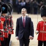 The Spanish King followed by the Duke of Edinburgh inspects the Guard of Honour the 1st Battalion Irish Guards.