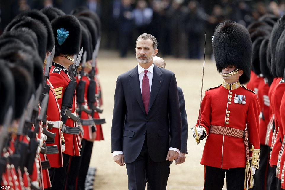 The Spanish King, followed by the Duke of Edinburgh, inspects the Guard of Honour, the 1st Battalion Irish Guards.