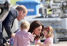 The adorable tot needed some encouragement before she embarked the helicopter with her parents and older brother Prince George. Photo (C) GETTY IMAGES