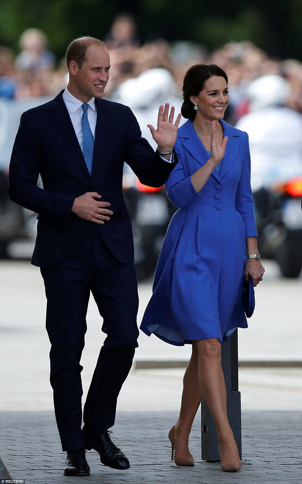 The couple looked thrilled with the rapturous reception they received, following a private lunch with Chancellor Angela Merkel