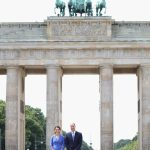 The couple pose in front of the most recognisable symbol of Germany both as a divided nation in the bleak days of the Cold War