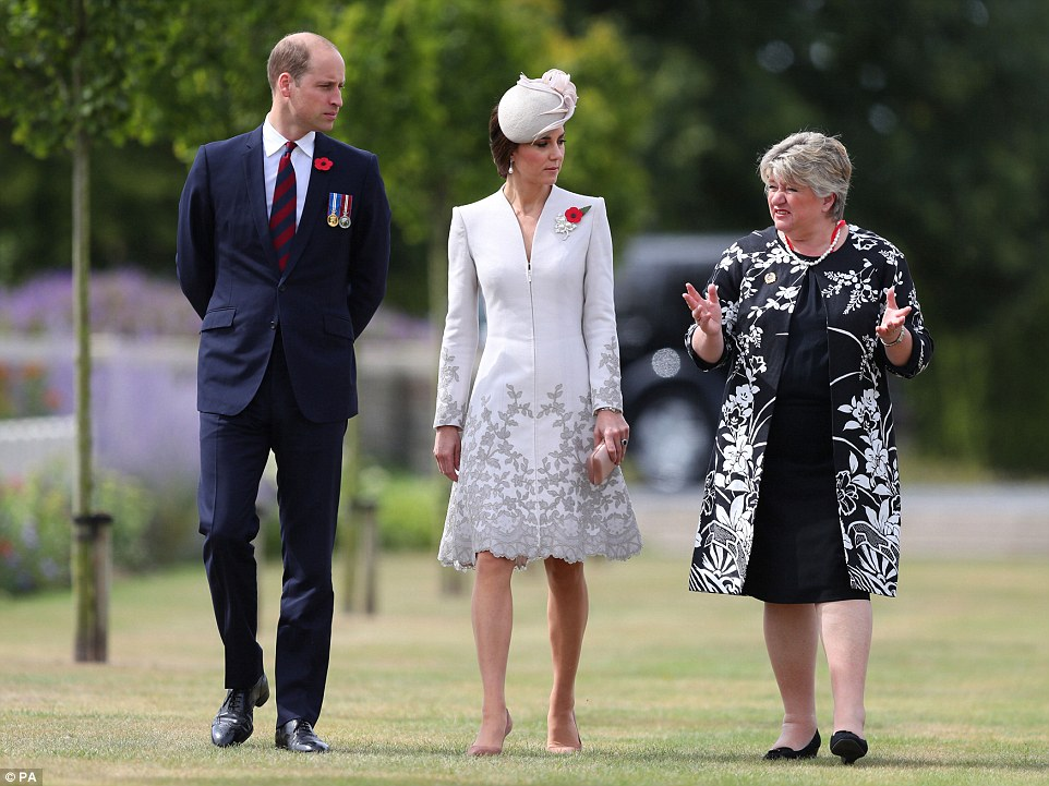 1 The Duchess wore a poppy and a diamond and pearl leaf brooch on her pale grey Catherine Walker coat