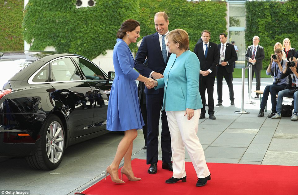The diplomatic Duchess donned Cornflower blue to meet with the German Chancellor Angela Merkel, who looked smart in a turquoise jacket and white trousers