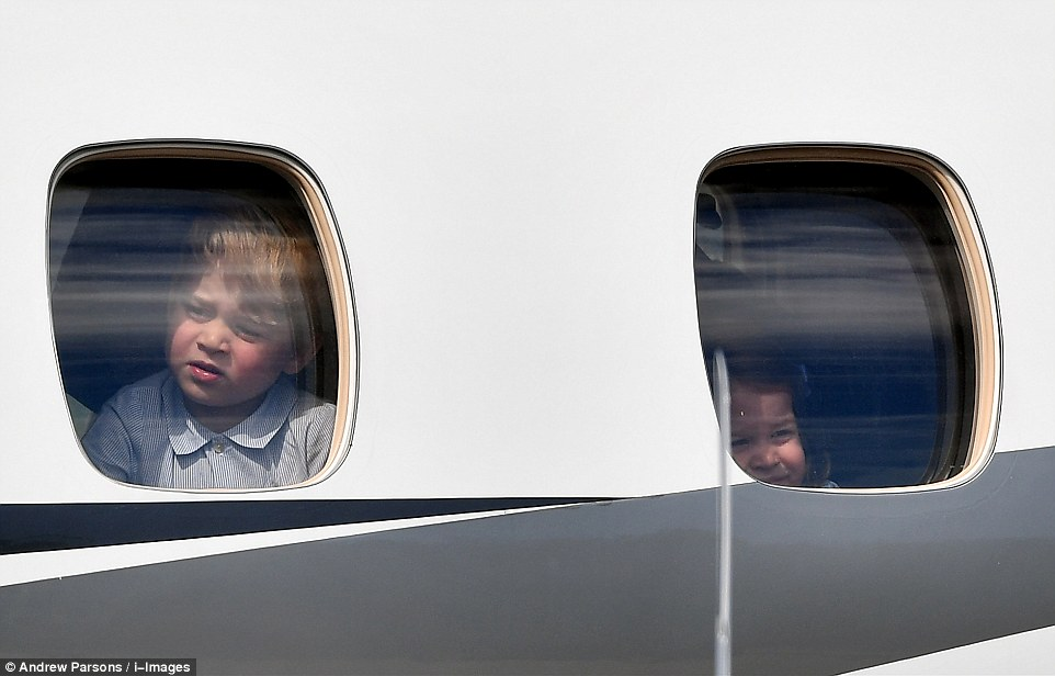 The little Prince and Princess could be seen peering out the window of their private plane before departing for Berlin