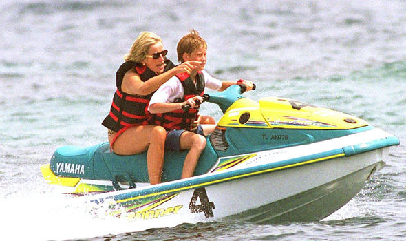Diana was the vision of happiness as she frolicked on a beach with her son Prince Harry Photo (C) GETTY