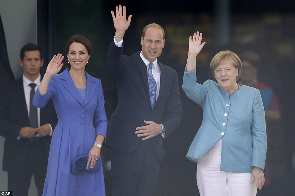 The trio wave as they prepare to enjoy lunch together at the chancellery in Berlin