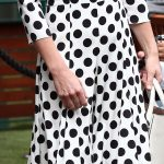 Today she opted for more fashion forward strappy sandals to complement her polka dots