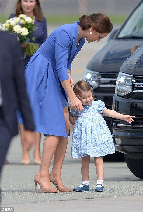 Get a move on! Princess Charlotte was eager to get going and board the plane as her mother paused to shake handson! Princess Charlotte was eager to get going and board the plane as her mother paused to shake hands