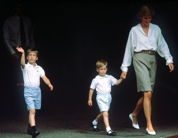 Princess Diana holds Prince Harry's hand as Prince William walks alongside (Image PA Wire)