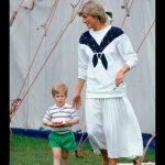 Diana Princess of Wales with Prince Harry carrying a plate of strawberries. 14 06 1987