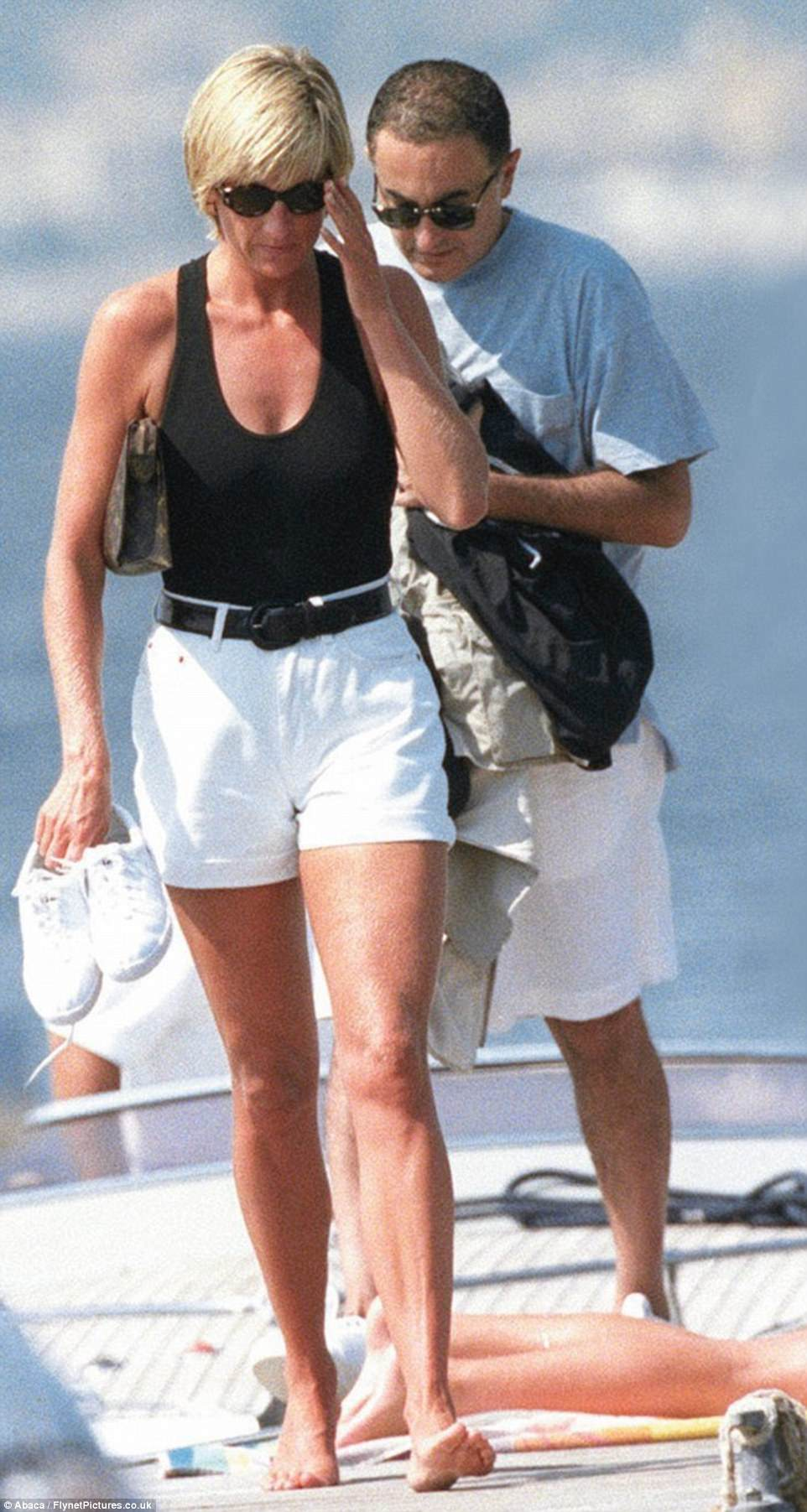 In this last picture Diana peers at pursuing paparazzi while Henri Paul right is caught wide eyed by the flashes and bodyguard Trevor Rees Jones looks anxious