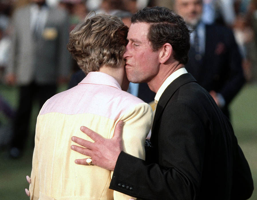 Getty Images Diana, Princess of Wales and Prince Charles, Prince of Wales kiss during a prize giving ceremony at a polo match, 1992 Photo (C) GETTY