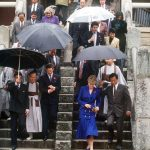 Getty Images The Prince and Princess of Wales are sheltered by umbrellas during a visit to the Pulguska Temple in Korea 1992 Photo C GETTY