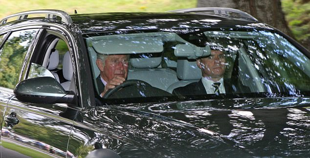 Prince Charles was spotted driving to Crathie Church at Balmoral this morning where he is holidaying with other family members