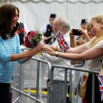 Kate is offered flowers by spectators as she visits the historic center of southern German town of Heidelberg