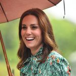 Kate protected her hair from the rain Photo C GETTY IMAGES