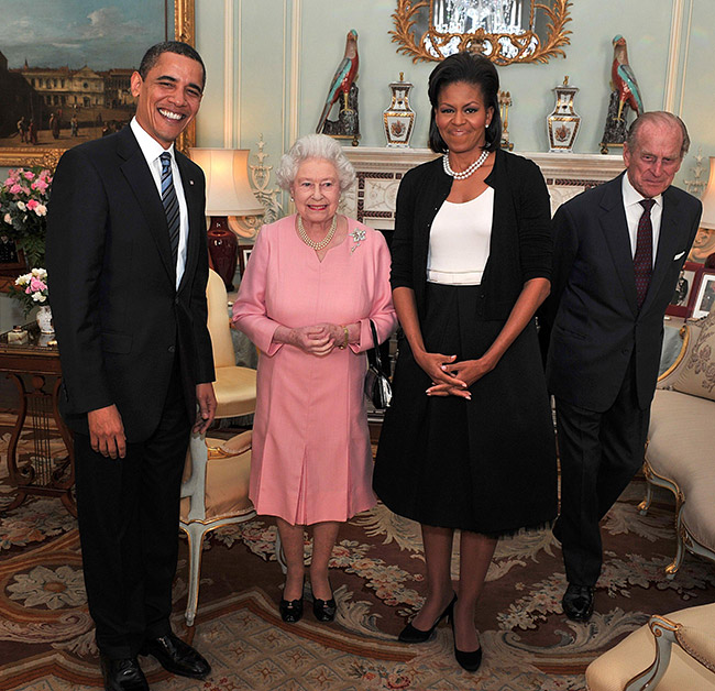 Michelle Obama famously breached protocol in 2009 when she put her arm around the monarch Photo (C) GETTY IMAGES