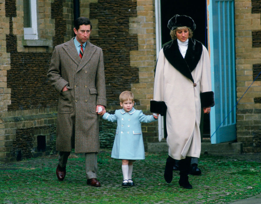 Prince Charles, Prince Harry and Princess Diana holding hands as they arrive for a photocall at Sandringham. 03 01 1988 Photo (C) GETTY IMAGES