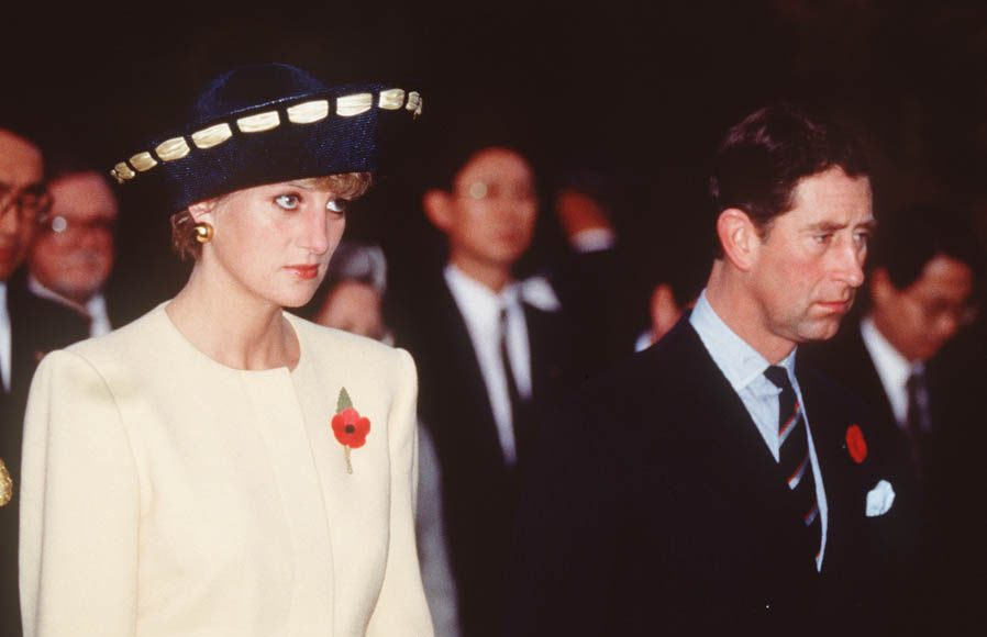 Prince Charles, Prince of Wales and Diana, Princess of Wales look sad as they arrive in Seoul for the start of their visit to South Korea, 1992. Photo (C) GETTY IMAGES