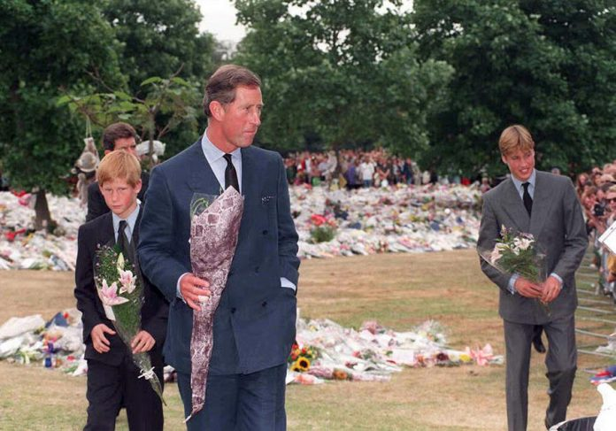 Prince Charles and sons Princes William and Harry place floral tributes to their mother, Diana, Princess of Wales, at Kensington Palace, her former London residence in 1997. Photo (C) GETTY