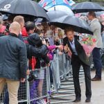Prince Harry accepts floral tributes for Princess Diana Photo C WENN