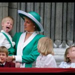 Prince Harry sticks out his tongue much to the suprise of his mother Princess Diana. 11 06 1988