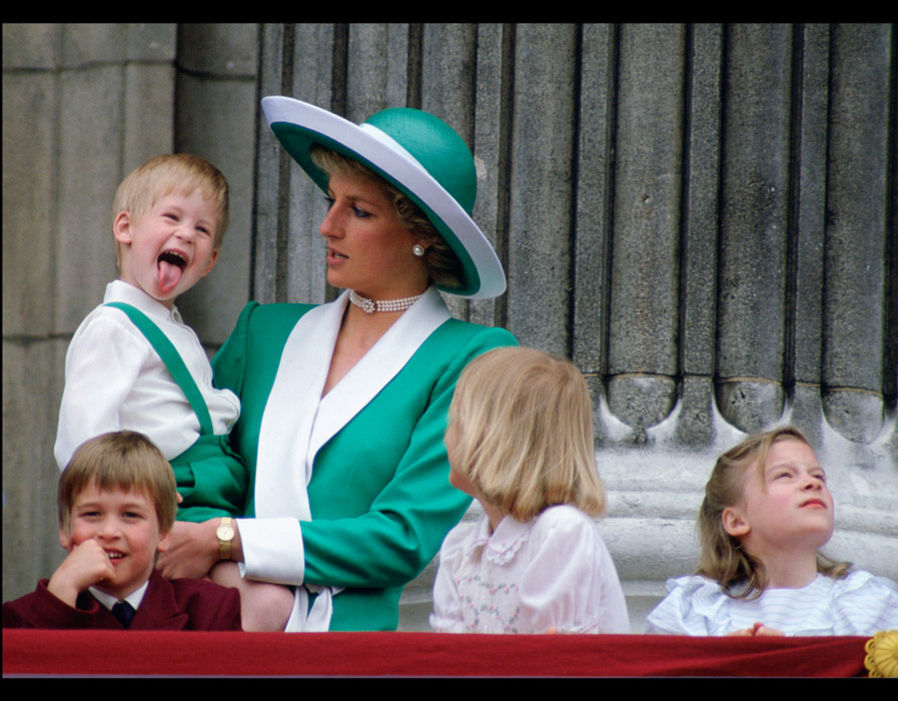 Prince Harry sticks out his tongue much to the surprise of his mother, Princess Diana. 11 06 1988 Photo (C) GETTY IMAGES