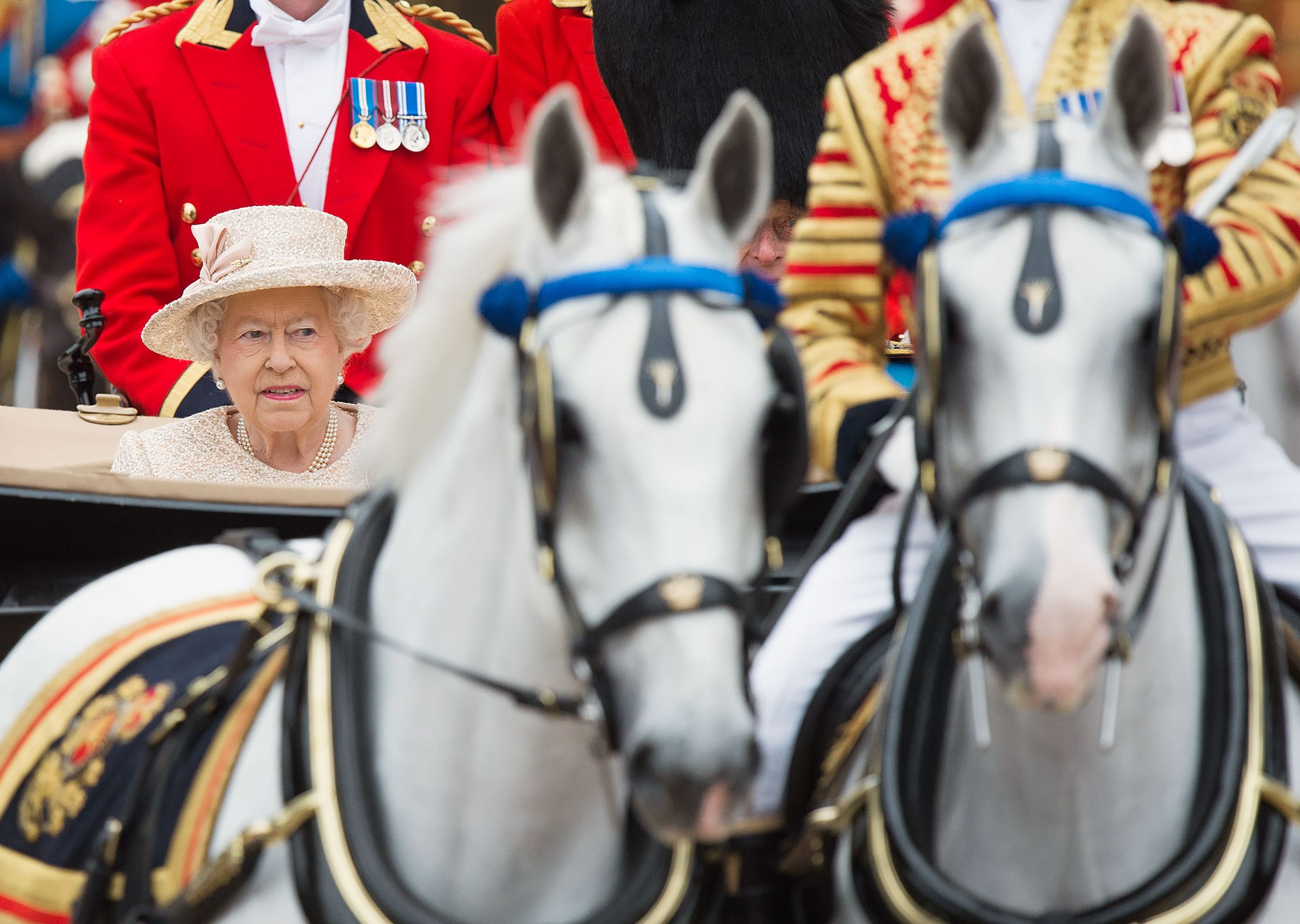 LONDON, ENGLAND - JUNE 13: Queen Elizabeth II rides in a carriage as she attends the annual Trooping The Colour ceremony at Horse Guards Parade on June 13, 2015 in London, England. (Photo by Samir Hussein/WireImage)