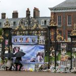 Prince William Duke of Cambridge and Prince Harry look upon flowers photos and other souvenirs left as a tribute to Princess Diana near The Sunken Garden at Kensington Palace. Photo C PA