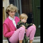 Princess Diana sitting outside Highgrove with her son Prince Harry who wears a soldier uniform. July 18th 1986 Photo C GETTY IMAGES