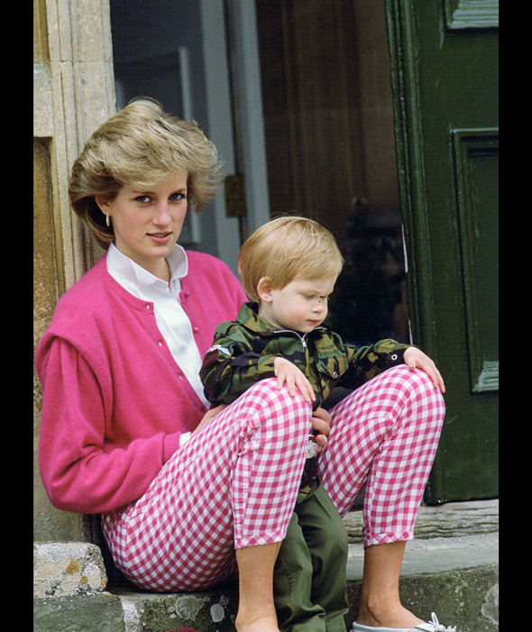 Princess Diana sitting outside Highgrove with her son Prince Harry who wears a soldier uniform. July 18th, 1986 Photo (C) GETTY IMAGES
