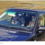 Queen Elizabeth II driving land cruiser while Kate Middleton Sitting beside her Photo C REX