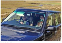 Queen Elizabeth II driving land cruiser while Kate Middleton Sitting beside her Photo (C) REX