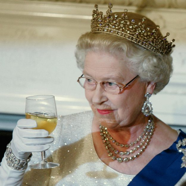 Queen Elizabeth is partial to a glass of champers Getty