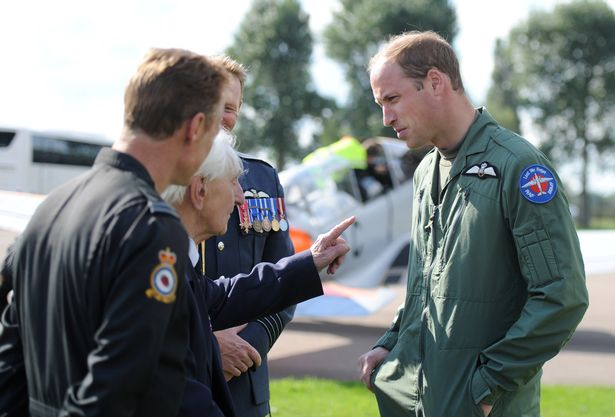 Veteran Ken Wilkinson jokingly telling off Prince William for flying choppers at RAF Coningsby in 2015 (Image Anna Draper)
