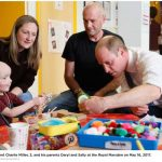 William joins patient Charlie Miller 3 and his parents Daryl and Sally at the Royal Marsden on May 16 2017