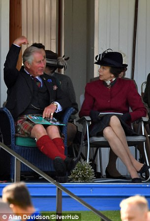Front row seats not good enough Prince Charles and Princess Anne chatted before Charles put his hands to his eyes like binoculars