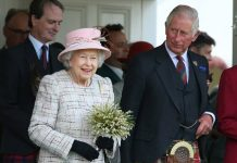 A smiling Queen was joined by Prince Charles (right) at the Scottish village's historic event