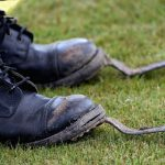 A tug o war competitor gets their specialised boots dirty as they compete