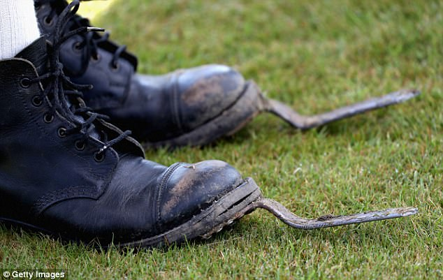 A tug-o-war competitor gets their specialised boots dirty as they compete