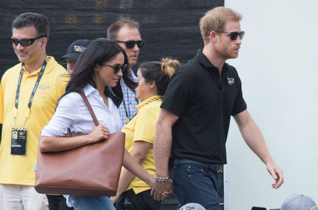 Andrea observed that Harry held Meghan's hand in the dominant position Photo (C) GETTY