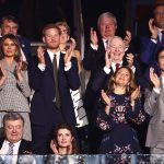 As the proceedings got underway Melania and Harry rose to their feet along with the rest of the guests in the VIP box