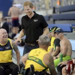 Australian swim team athletes were all ears as the prince toured the complex