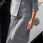 Dressed in a Dior suit and trademark sunglasses the 47 year old appeared poised as she made her way to Torontos Sheraton Hotel