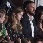 Dressed in a plum leather jacket and matching dress the actress smiled and chatted with Markus Anderson who introduced her to Prince Harry last year