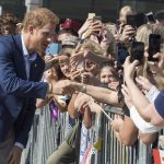 Earlier Prince Harry was greeted by crowds of adoring fans and a even a couple of dogs as he left following a meeting at The Centre for Addiction and Mental Health on Saturday