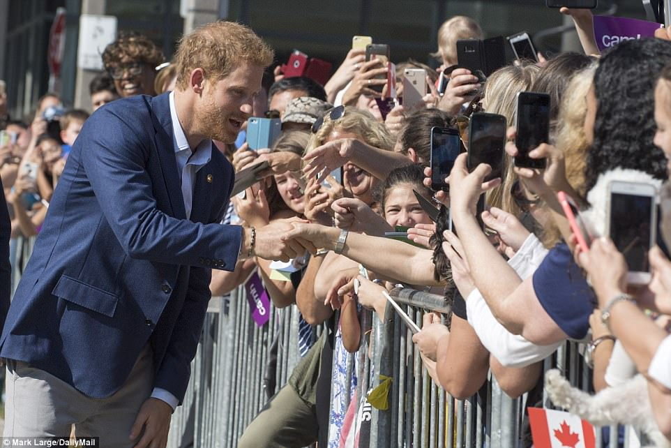Earlier, Prince Harry was greeted by crowds of adoring fans - and a even a couple of dogs - as he left following a meeting at The Centre for Addiction and Mental Health on Saturday