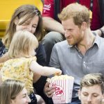 Prince Harry shares his pop corn with Emily Henson, daughter of Hayley Henson (left) as he attends the Sitting Volleyball Finals at Mattamy Athletic Centre during the 2017 Invictus Games in Toronto, Canada. PRESS ASSOCIATION Photo. Picture date: Wednesday September 27, 2017. Photo credit should read: Danny Lawson/PA Wire